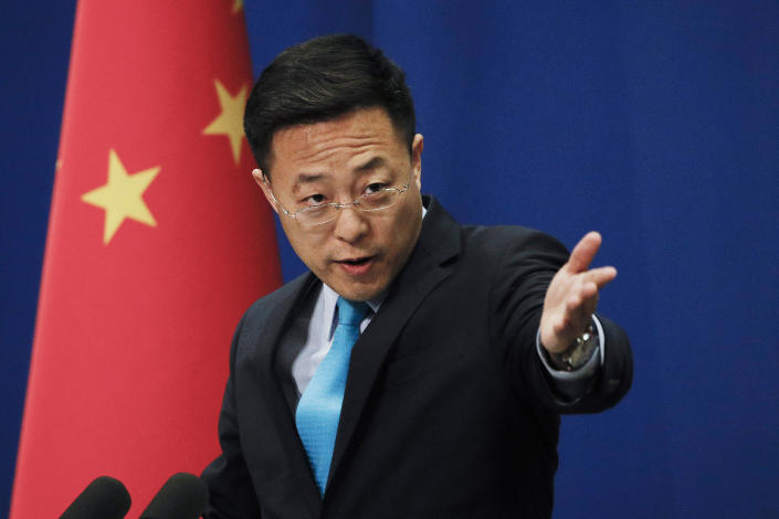 """FILE - In this file photo taken Monday, Feb. 24, 2020, Chinese Foreign Ministry spokesperson Zhao Lijian gestures as he speaks during a daily briefing at the Ministry of Foreign Affairs office in Beijing. Zhao on Wednesday, March 17, 2021, said China has protested to the United States and Japan over a joint statement it said """"maliciously attacked"""" its foreign policy and seriously interfered in China's internal affairs. (AP Photo/Andy Wong, File)"""