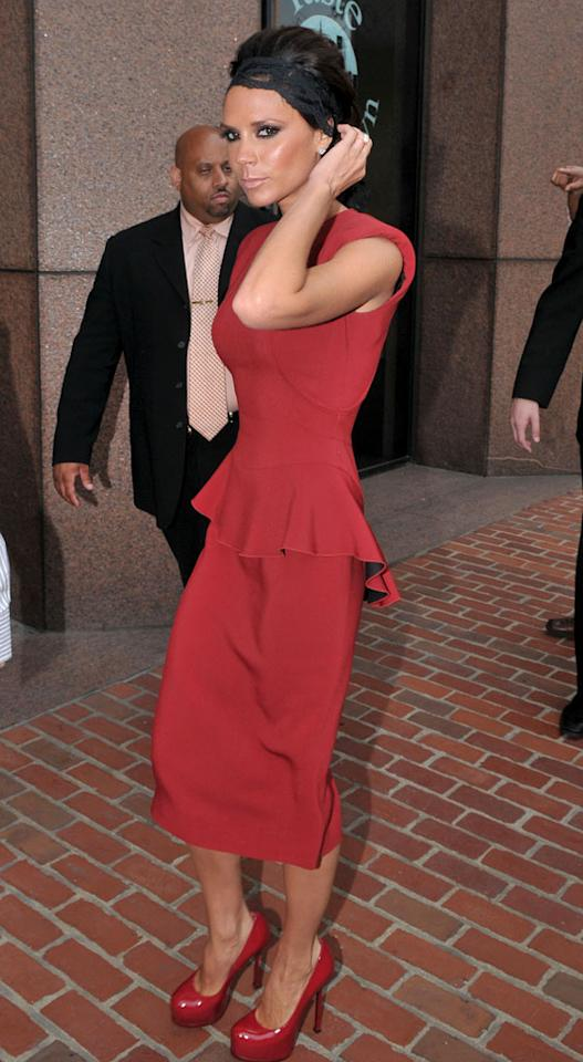"""Minus the lacy headband, guest judge Victoria Beckham was looking quite lovely in red. Shane Conway/<a href=""""http://www.splashnewsonline.com"""" target=""""new"""">Splash News</a> - August 13, 2009"""