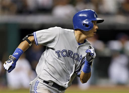 Toronto Blue Jays' Munenori Kawasaki runs to first on a bases-loaded single off Cleveland Indians relief pitcher Joe Smith to drive in three runs in the ninth inning of a baseball game Wednesday, July 10, 2013, in Cleveland. (AP Photo/Mark Duncan)