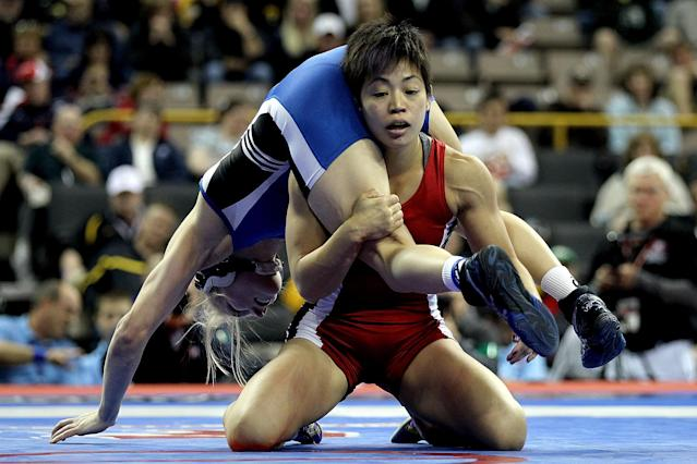 IOWA CITY, IA - APRIL 22: Clarissa Chun (red) wrestles Alyssa Lampe (blue) in the 48 kg freestyle weight class during the finals of the US Wrestling Olympic Trials at Carver Hawkeye Arena on April 22, 2012 in Iowa City, Iowa. (Photo by Matthew Stockman/Getty Images)