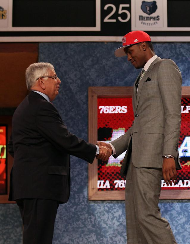 NEWARK, NJ - JUNE 28: Moe Harkless (R) of St. John's Red Storm greets NBA Commissioner David Stern (L) after he was selected number fifteen overall by the Philadelphia 76ers during the first round of the 2012 NBA Draft at Prudential Center on June 28, 2012 in Newark, New Jersey. NOTE TO USER: User expressly acknowledges and agrees that, by downloading and/or using this Photograph, user is consenting to the terms and conditions of the Getty Images License Agreement. (Photo by Elsa/Getty Images)