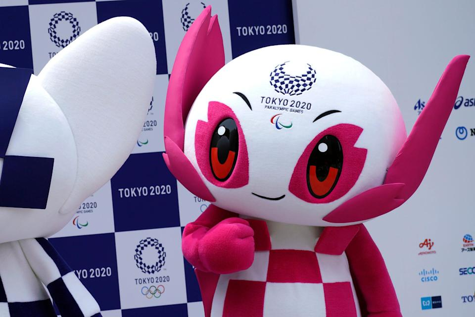 """2020 Paralympic mascot """"Someity"""" stands at stage during their debut event in Tokyo."""