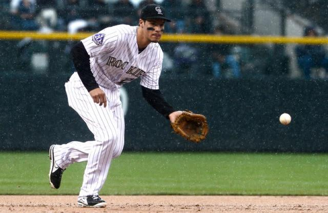 Colorado Rockies' Arenado stops a ground ball against the New York Yankees during their inter-league MLB baseball game in Denver