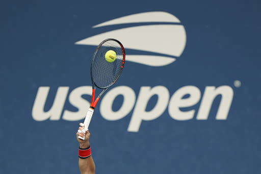 Diego Schwartzman, of Argentina, serves to Cameron Norrie, of Great Britain, during the first round of the US Open tennis championships, Monday, Aug. 31, 2020, in New York. (AP Photo/Frank Franklin II)