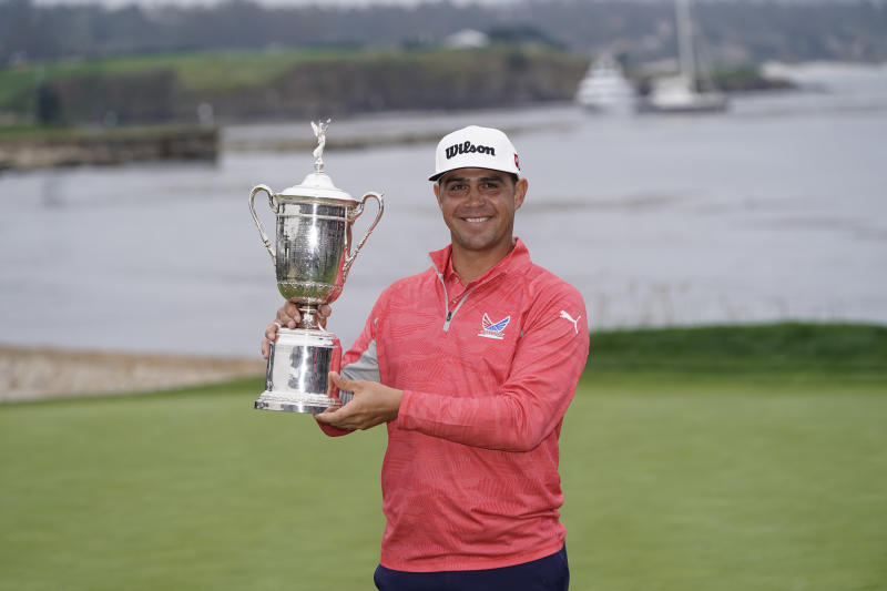 Gary Woodland posses with the trophy after winning the U.S. Open Championship golf tournament Sunday, June 16, 2019, in Pebble Beach, Calif. (AP Photo/David J. Phillip)