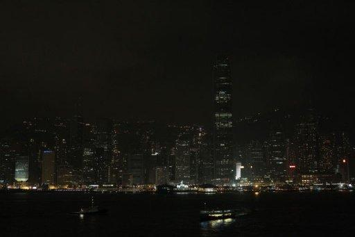 Hong Kong's Victoria harbour waterfront is seen with its lights dimmed during Earth Hour. Australia's Sydney Harbour Bridge and Opera House were plunged into darkness for the annual Earth Hour campaign, leading a global effort to raise awareness about climate change