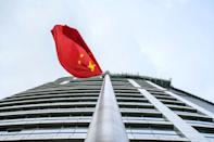 """Critics say Hong Kong's new national security law violates the """"One Country, Two Systems"""" arrangement in place since Britain returned the former colony to China in 1997"""