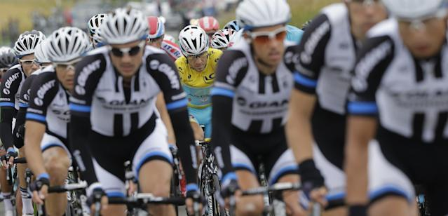 Italy's Vincenzo Nibali, wearing the overall leader's yellow jersey, follows Giant Shimano team riders as they set the pace of the pack in the chase on the breakaway group during the sixth stage of the Tour de France cycling race over 194 kilometers (120.5 miles) with start in Arras and finish in Reims, France, Thursday, July 10, 2014. (AP Photo/Laurent Cipriani)