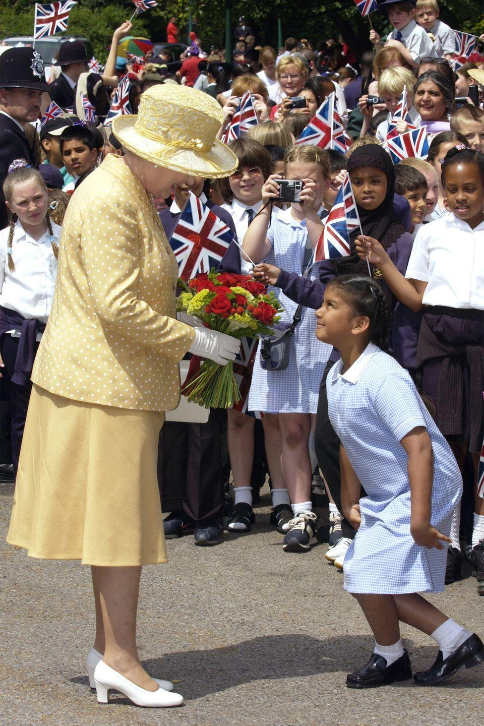 <p>QEII looked delighted to meet a young girl who greeted her with a curtsey. The royal enjoyed a picnic at Gunnersbury Park celebrating the diversity of West London.<br></p>