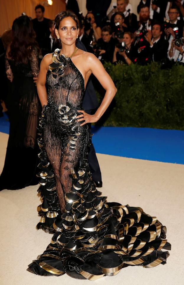 <p>Halle barely covered her modesty in a transparent metallic gown by Atelier Versace.<br /><i>[Photo: Reuters]</i> </p>