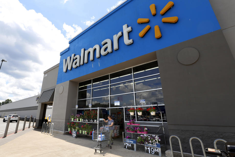 FILE - This June 25, 2019, file photo shows the entrance to a Walmart in Pittsburgh. Walmart reports its third quarter earnings on Thursday, Nov. 14. (AP Photo/Gene J. Puskar, File)