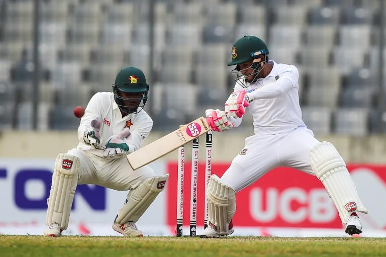 Bangladesh's Mushfiqur Rahim plays a shot as Zimbabwe's Regis Chakabva keeps wicket on the second day of their Test at the Sher-e-Bangla National Cricket Stadium in Dhaka (AFP Photo/MUNIR UZ ZAMAN)