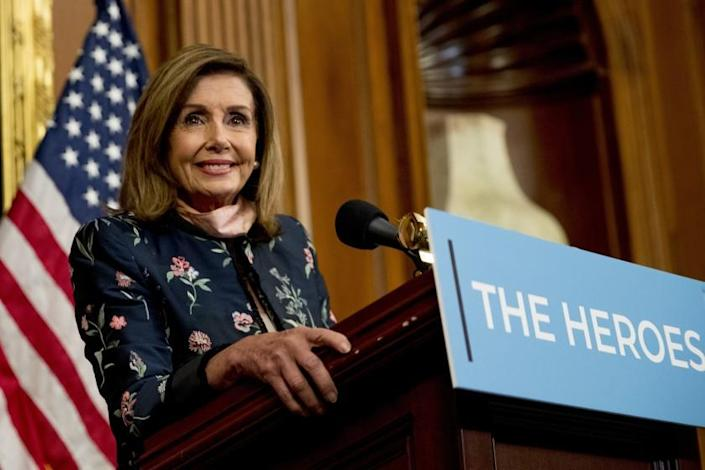 """House Speaker Nancy Pelosi of Calif. smiles as she takes a question from a reporter during a news conference on Capitol Hill in Washington, Wednesday, July 15, 2020, to mark two months since House passage of """"The Heroes Act"""" or the Health and Economic Recovery Omnibus Emergency Solutions Act. (AP Photo/Andrew Harnik)"""
