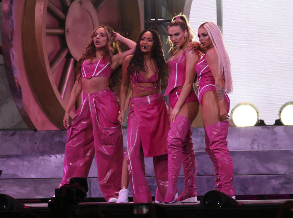 """FILE - Little Mix perform onstage at the Brit Awards in London, Wednesday, Feb. 20, 2019. The South Korean boy band BTS HAS won a leading four awards including best song for """"Dynamite"""" and best group at the MTV Europe Music Awards Sunday, Nov. 8, 2020 while Lady Gaga took home the best artist prize. (Photo by Joel C Ryan/Invision/AP, File)"""