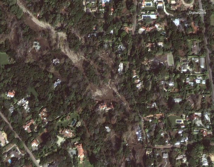 <p>This Jan. 11, 2018 satellite image released by DigitalGlobe News Bureau shows an area of homes after storms caused mudslides and flooding in Montecito, Calif. (Photo: DigitalGlobe News Bureau via AP) </p>