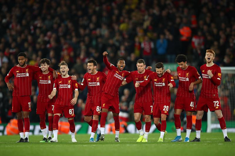 LIVERPOOL, ENGLAND - OCTOBER 30: Players of Liverpool celebrate during the penalty shoot out during the Carabao Cup Round of 16 match between Liverpool and Arsenal at Anfield on October 30, 2019 in Liverpool, England. (Photo by Robbie Jay Barratt - AMA/Getty Images)