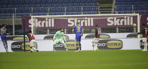 Parma's Hernani, left, scores his side's first goal during a Serie A soccer match between AC Milan and Parma, at the San Siro stadium in Milan, Italy, Sunday, Dec. 13, 2020. (AP Photo/Luca Bruno)