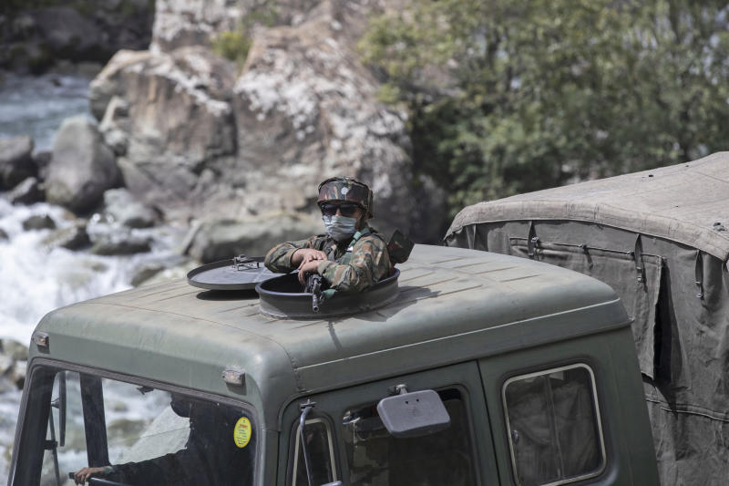 """An Indian army soldier keeps guard on top of his vehicle as their convoy moves on the Srinagar- Ladakh highway at Gagangeer, northeast of Srinagar, Indian-controlled Kashmir, Tuesday, Sept. 1, 2020. India said Monday its soldiers thwarted """"provocative"""" movements by China's military near a disputed border in the Ladakh region months into the rival nations' deadliest standoff in decades. China's military said it was taking """"necessary actions in response,"""" without giving details. (AP Photo/Mukhtar Khan)"""