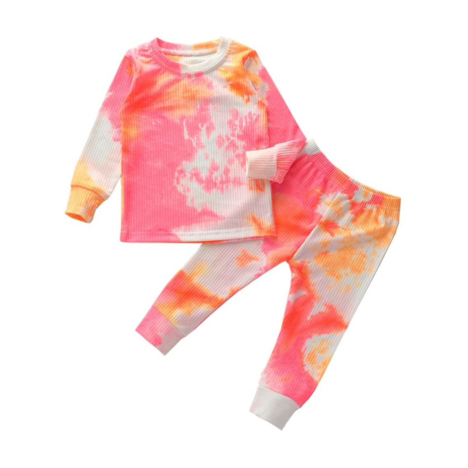 """<p><strong>Rah Love's Boutique</strong></p><p>rahlovesboutique.com</p><p><strong>$24.99</strong></p><p><a href=""""https://www.rahlovesboutique.com/products/tie-dye-lounge-set-pink-orange"""" rel=""""nofollow noopener"""" target=""""_blank"""" data-ylk=""""slk:Shop Now"""" class=""""link rapid-noclick-resp"""">Shop Now</a></p><p><a href=""""https://www.goodhousekeeping.com/home/g34416701/best-tie-dye-kit/"""" rel=""""nofollow noopener"""" target=""""_blank"""" data-ylk=""""slk:Tie dye"""" class=""""link rapid-noclick-resp"""">Tie dye</a> is huge, and if your kid is a fan, they can wear it from head to toe with this set. It comes in five different color combos, from black and white to pastel pink and blue. Pick up one of Rah Love's """"<a href=""""https://www.rahlovesboutique.com/products/love-always-tulle-sleeve-t-shirt"""" rel=""""nofollow noopener"""" target=""""_blank"""" data-ylk=""""slk:Love Always"""" class=""""link rapid-noclick-resp"""">Love Always</a>"""" t-shirts to go with the pants, and you can get two looks into one V-Day gift.</p>"""