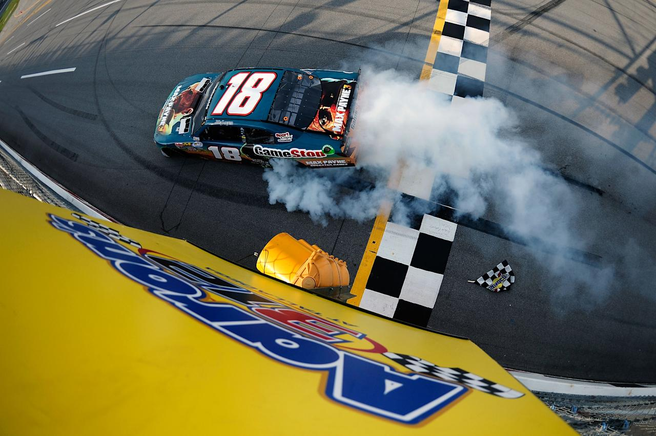 TALLADEGA, AL - MAY 05:  Joey Logano, driver of the #18 GameStop Toyota, perfoms a burnout to celebrate after winning the NASCAR Nationwide Series Aaron's 312 at Talladega Superspeedway on May 5, 2012 in Talladega, Alabama.  (Photo by Jared C. Tilton/Getty Images)