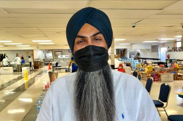 Amanpreet Singh Gill, president of the Dashmesh Culture Centre, says everyone is welcome to cool off in the centre's large basement area while enjoying some cold drinks to beat the heat. (Dan McGarvey/CBC - image credit)