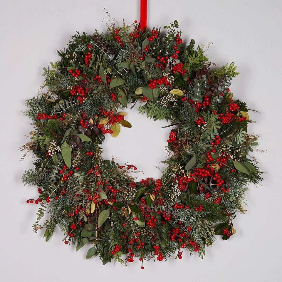 "<p>New online flower delivery service Bloom has nine wreath options available, but we are fans of the traditional colours and generous proportions of this mixture of red berries and eucalyptus. Pre-order now for delivery on 8 December. From £160, <a href=""https://www.bybloom.co.uk/christmas/winter-berry-wreath/"" rel=""nofollow noopener"" target=""_blank"" data-ylk=""slk:bybloom.co.uk"" class=""link rapid-noclick-resp"">bybloom.co.uk</a></p>"