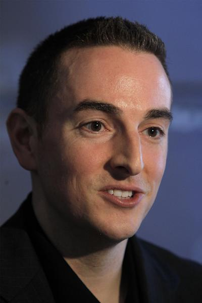"""Memphis Grizzlies new chairman Robert Pera speaks at a press conference in Memphis, Tenn., Monday, Nov. 5, 2012. The new chairman of the Grizzlies said he """"fully understands"""" that the people of Memphis really own the NBA team, even though he's the controlling owner. (AP Photo/Lance Murphey)"""