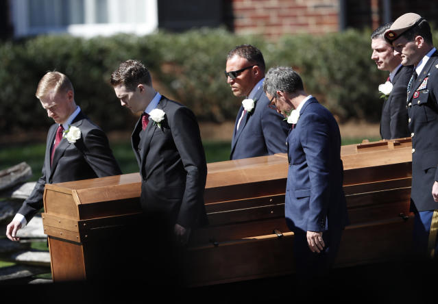 <p>The casket of The Rev. Billy Graham is moved during a funeral service at the Billy Graham Library for the Rev. Billy Graham, who died last week at age 99, Friday, March 2, 2018, in Charlotte, N.C. (Photo: John Bazemore/AP) </p>