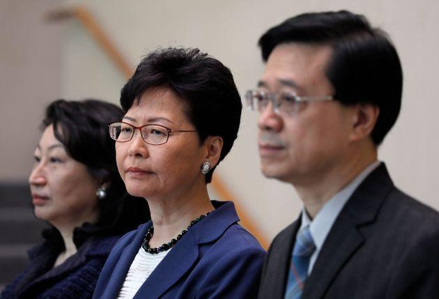 Hong Kong secretary for security John Lee, right, Hong Kong chief executive Carrie Lam, centre, and secretary of justice Teresa Cheng listen to reporters questions during a press conference