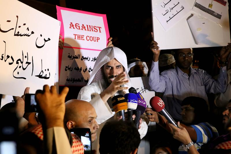 Kuwaiti islamist Shafi al-Ajmi (C) adressing the audience during a protest outside the Egyptian embassy against Egypt's bloody crackdown on supporters of ousted president Mohamed Morsi on August 14, 2013 in Kuwait City