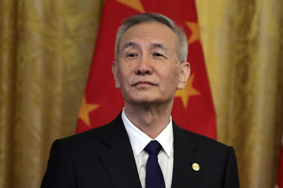 """FILE - In this Jan. 15, 2020, file photo, Chinese Vice Premier Liu He listens as former President Donald Trump speaks before signing a trade agreement at the White House in Washington. China and the U.S. held a virtual meeting on Saturday, Oct. 9, 2021, regarding the two countries' fraught trade relationship, after a lengthy break in negotiations. China's top trade negotiator Liu He called U.S. Trade Representative Katherine Tai to discuss the """"Phase 1"""" trade deal, negotiated under the Trump administration, along with other major economic concerns, according to a statement from China's Commerce Ministry. (AP Photo/Evan Vucci, File)"""