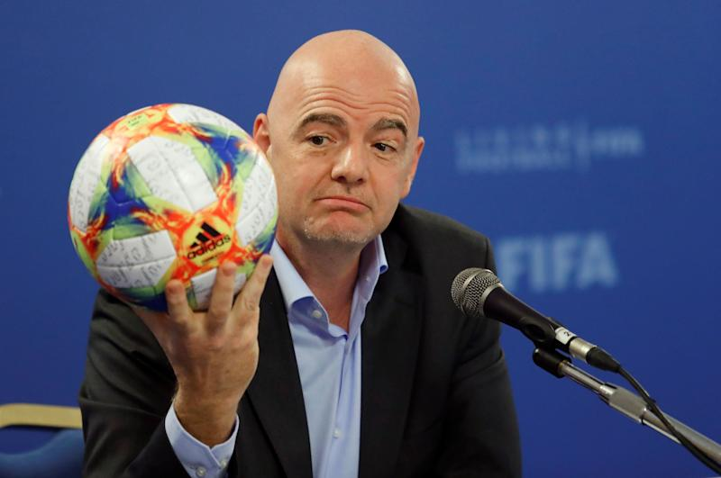 FIFA President Gianni Infantino shows an official ball of the 2019 FIFA Women's World Cup during his news conference in Rome, Italy, February 27, 2019. REUTERS/Remo Casilli