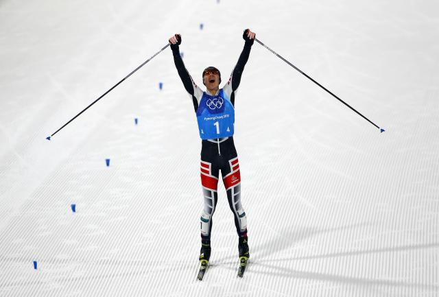 Nordic Combined Events - Pyeongchang 2018 Winter Olympics - Men's Team 4 x 5 km Final - Alpensia Cross-Country Skiing Centre - Pyeongchang, South Korea - February 22, 2018 - Mario Seidl of Austria celebrates as he approaches the finish line. REUTERS/Dominic Ebenbichler