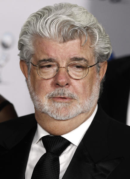 File - In this Feb. 17, 2012 file photo, George Lucas is shown arriving at the 43rd NAACP Image Awards in Los Angeles. Lucasfilm Ltd., the force behind the Star Wars movies, said it has abandoned plans to build a big digital production studio on historic farmland in northern California, citing opposition from neighbors worried the environmental impact. The company owned by filmmaker George Lucas said it planned to construct new facilities elsewhere. (AP Photo/Matt Sayles, file)