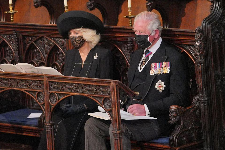 <p>Prince Charles and Camilla, Duchess of Cornwall, inside St George's Chapel. </p>