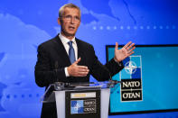 NATO Secretary General Jens Stoltenberg gestures during an online news conference following a NATO Foreign Ministers video meeting following developments in Afghanistan at the NATO headquarters in Brussels, Friday, Aug. 20, 2021. NATO Foreign Ministers are meeting in a videoconference to assess the chaotic situation in Afghanistan and coordinate efforts to get nationals and key local staff out of the country. (AP Photo/Francisco Seco, Pool)