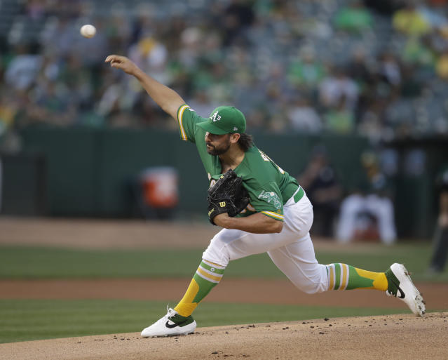 Oakland Athletics pitcher Tanner Roark works against the Houston Astros during the first inning of a baseball game Friday, Aug. 16, 2019, in Oakland, Calif. (AP Photo/Ben Margot)