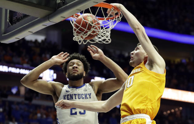 Tennessee forward John Fulkerson (10) dunks against Kentucky forward EJ Montgomery (23) in the first half of an NCAA college basketball game at the Southeastern Conference tournament Saturday, March 16, 2019, in Nashville, Tenn. (AP Photo/Mark Humphrey)