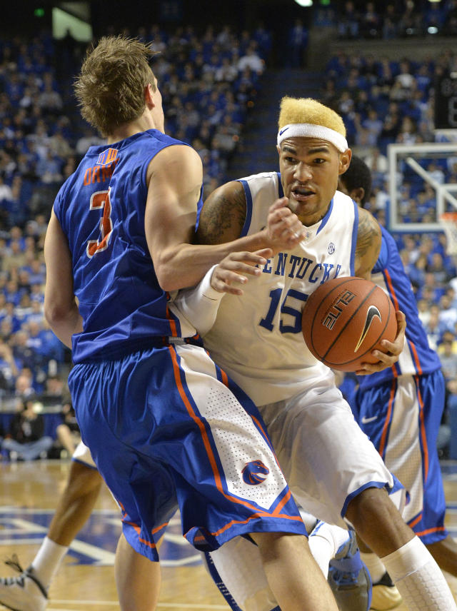 Kentucky's Willie Cauley-Stein, right, charges into the defense of Boise State's Anthony Drmic during the second half of an NCAA college basketball game Tuesday Dec. 10, 2013, in Lexington, Ky. Kentucky won 70-55. (AP Photo/Timothy D. Easley)