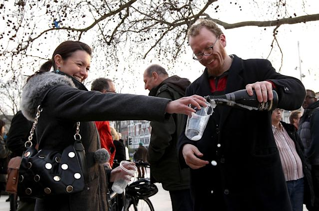LONDON, UNITED KINGDOM - APRIL 08: People pour a drink as others celebrate following the announcement of the former British Prime Minister Margaret Thatcher's death in Brixton on April 8, 2013 in London, England. Lady Thatcher has died this morning following a stroke aged 87. Margaret Thatcher was the first female British Prime Minster and governed the UK from 1979 to 1990. She led the UK through some turbulent years and contentious issues including the Falklands War, the miners' strike and the Poll Tax riots. (Photo by Danny E. Martindale/Getty Images)
