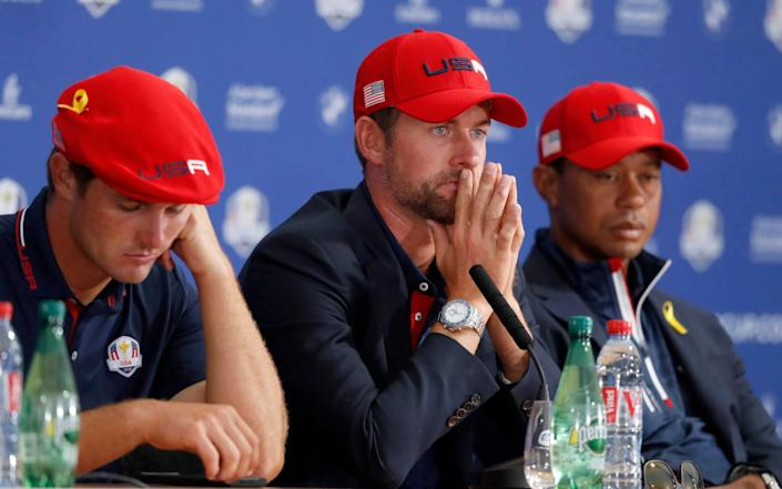 US players Bryson Dechambeau, left, Webb Simpson, center, and Tiger Woods attend the press conference - AP