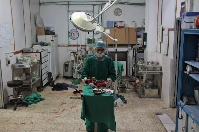 Once operations are over in Syria's rebel-held Douma, doctors re-sterilise their gloves and surgical equipment so they can be used again (AFP Photo/Hamza Al-Ajweh)