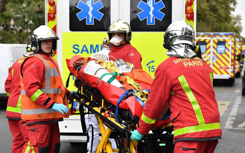 Firefighters were seen rushing injured individuals into ambulances - ALAIN JOCARD/AFP