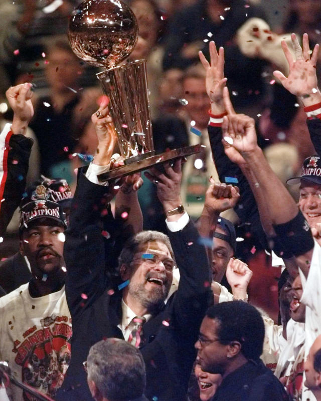 """FILE - In this June 13, 1997 file photo, Chicago Bulls coach Phil Jackson hoists the trophy aloft after the Bulls beat the Utah Jazz 90-86 in Game 6 to win the NBA championship in Chicago. Jackson will be introduced as the newest member of the New York Knicks' front office Tuesday morning, according to a person familiar with the negotiations between the 11-time champion coach and the team. The person spoke on condition of anonymity on Friday, March 14, 2014, because the Knicks would only confirm that a """"major announcement"""" involving team executives was scheduled. (AP Photo/Morry Gash, File)"""