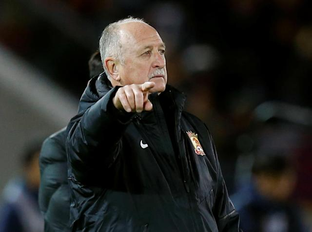 FILE PHOTO: Guangzhou Evergrande's head coach Luiz Felipe Scolari directs his players during their Club World Cup semi-final soccer match against Barcelona in Yokohama, south of Tokyo, Japan, December 17, 2015. REUTERS/Toru Hanai/File Photo