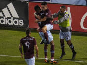 Colorado Rapids midfielder Mark-Anthony Kaye (14) celebrates a goal against Real Salt Lake with teammate Braian Galvan (52) during the second half of an MLS soccer match Saturday, Aug. 21, 2021, in Commerce City, Colo. (AP Photo/ Jack Dempsey)