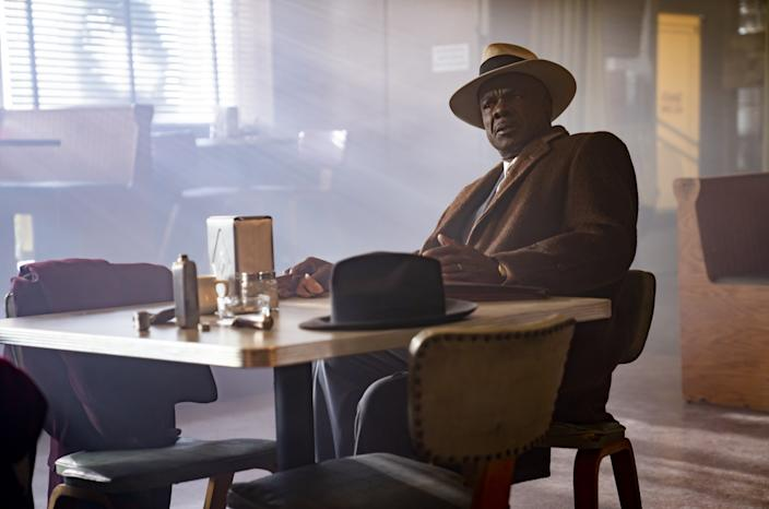 """Glynn Turman in character in """"Fargo"""" sits at a restaurant table with light streaming in the window behind him."""