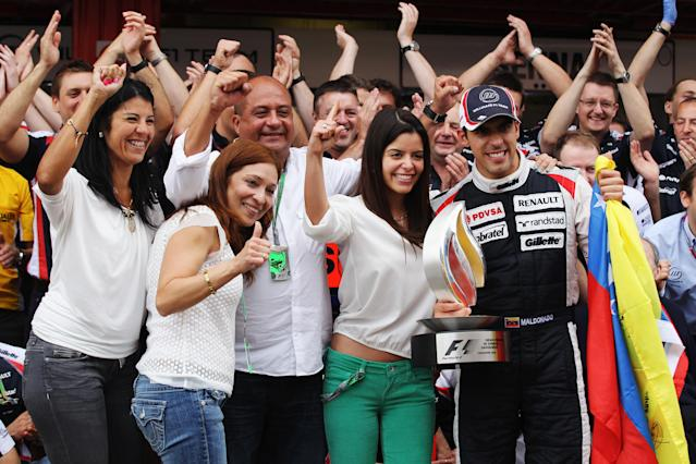 BARCELONA, SPAIN - MAY 13: Pastor Maldonado of Venezuela and Williams celebrates with team mates in the pitlane after winning the Spanish Formula One Grand Prix at the Circuit de Catalunya on May 13, 2012 in Barcelona, Spain. (Photo by Mark Thompson/Getty Images)
