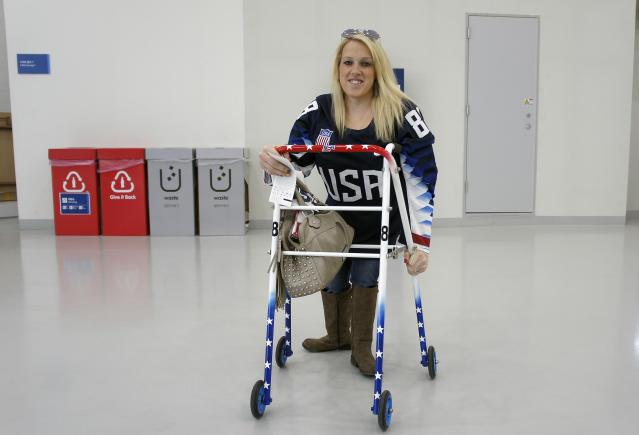 In this March 11, 2018, photo, Erica Mitchell, a Chicago native and an accomplished player in women's sled hockey, who came to the games as a spectator, poses at the Gangneung Hockey Center in Gangneung, South Korea. Mitchell was one of many people with disabilities who spoke to The Associated Press about accessibility problems at the Paralympic Games in South Koreas rural east, despite what organizers described as a perfectly organized event that provided the highest level of access. (AP Photo/Kim Tong-hyung)