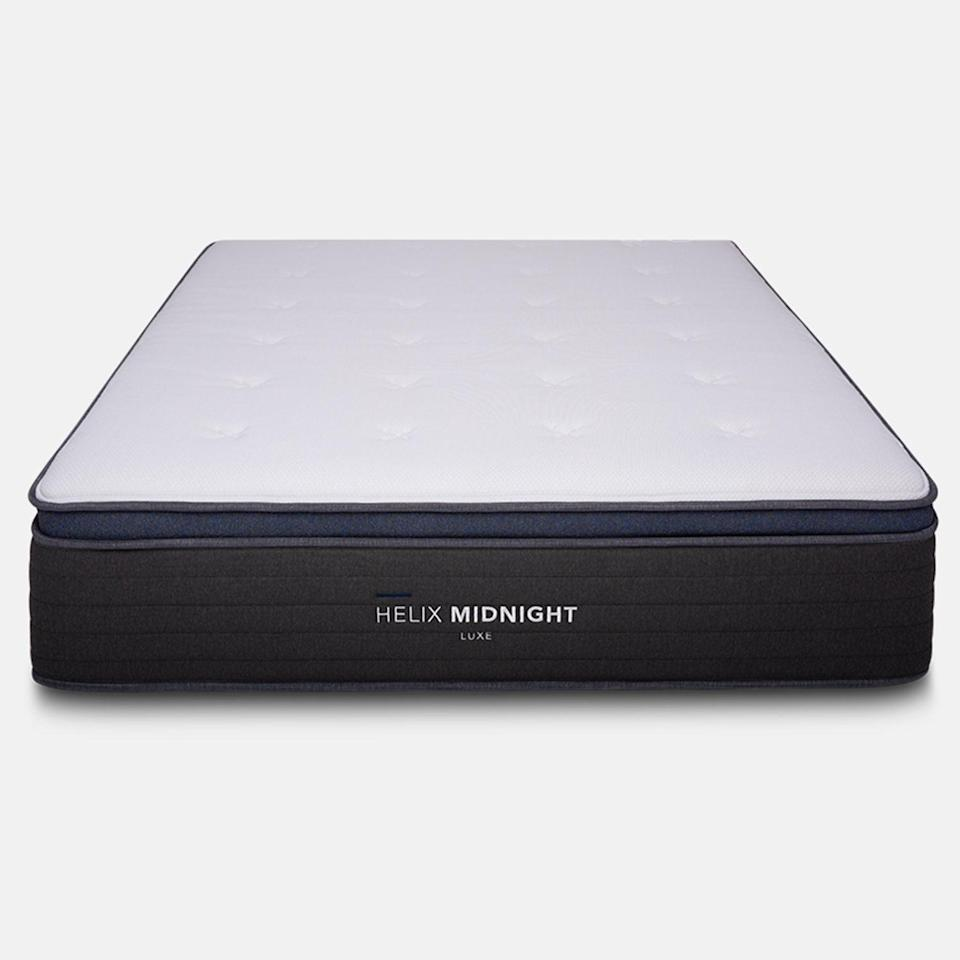 """<h3><a href=""""https://helixsleep.com/products/midnight-luxe"""" rel=""""nofollow noopener"""" target=""""_blank"""" data-ylk=""""slk:Helix Sleep Midnight LUXE Mattress"""" class=""""link rapid-noclick-resp"""">Helix Sleep Midnight LUXE Mattress</a></h3><br><strong>Mattress Type: </strong>Hybrid (Foam & Spring) <br><strong>Sleeper Style: </strong>Back & Side<br><strong>Pros: </strong>Soft-Yet-Firm Support<br><strong>Cons: </strong>Weight<br><br>""""Just last month, my partner and I got Helix's hybrid mattress the Midnight LUXE. Mattresses are extremely important for us: I have some back issues and my partner is an avid golfer who suffers from restless leg syndrome. And, before COVID hit, we traveled quite often which gave us the opportunity to sleep on an incredible number of mattresses over the years — so, as you can imagine, we've become unusually aware of the various properties that separate the high-quality ones from the absolute duds."""" <br><br>""""While our preferences for mattresses vary slightly, firmness is a main shared priority — but, since we're both fairly restless sleepers, there's a level of softness that's important when we inevitably end up tossing from our backs to our sides. Mattresses that are too firm often give me neck and shoulder pain when I'm on my side, and mattresses that are too soft tend to have the same effect when I'm sleeping on my back. Essentially, we'd been playing out the role of Goldilocks unendingly as we moved from too soft to too firm to finally just right. That's where the Midnight Luxe comes in with its as close to perfect (as we've yet to experience) blend of support and comfort for sleeping on our backs AND our sides."""" <br><br>""""The only real negative we experienced with our new Helix mattress was the challenge of getting it from our door to our bedroom: the box had to weigh over 200 pounds. Luckily we had some family available to help heave it inside — and once it was out of the box, the mattress unfolded easily and was very manageable to get set into place."""